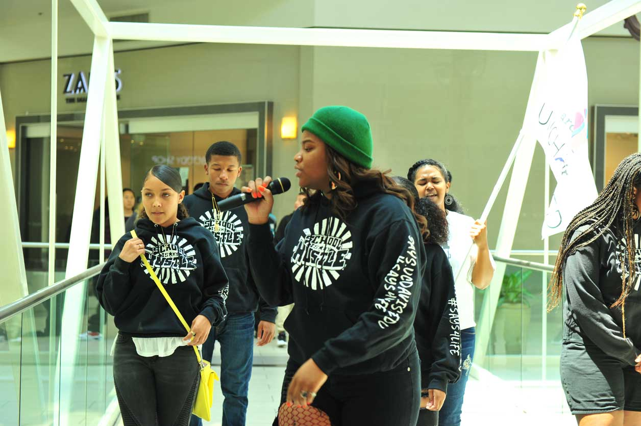 Image of SAYS Spoken Word Event - performer with mic