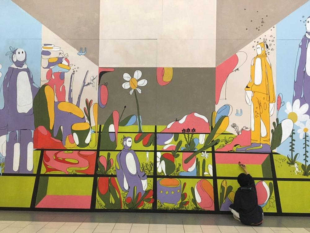 Image of Travis Cuellar Painting Mural