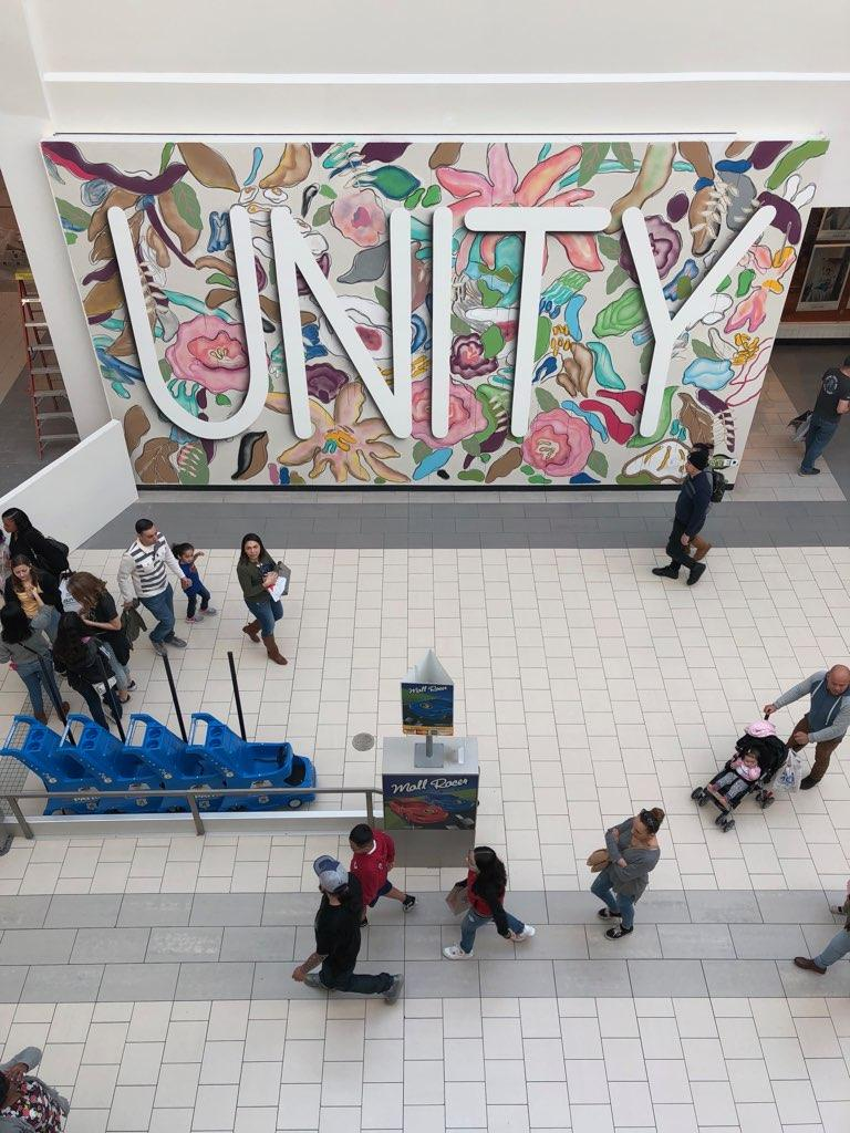 Image of Floral Unity Mural with people walking across